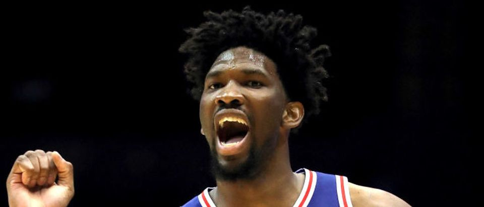 Joel Embiid #21 of the Philadelphia 76ers reacts to a call during the second quarter against the Brooklyn Nets during their Pre Season game at Nassau Veterans Coliseum on October 11, 2017 in Uniondale, New York. (Photo by Abbie Parr/Getty Images)