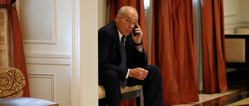 White House Chief of Staff John Kelly on his phone as U.S. President Donald Trump meets with Ukraine President Petro Poroshenko in New York