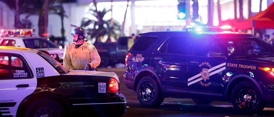 Las Vegas Metro Police officer stands by at a staging area in the intersection of Tropicana Avenue and Las Vegas Boulevard South after a mass shooting at a music festival on the Las Vegas Strip in Las Vegas
