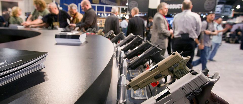 Sig Sauer handguns are displayed during the annual SHOT Show in Las Vegas