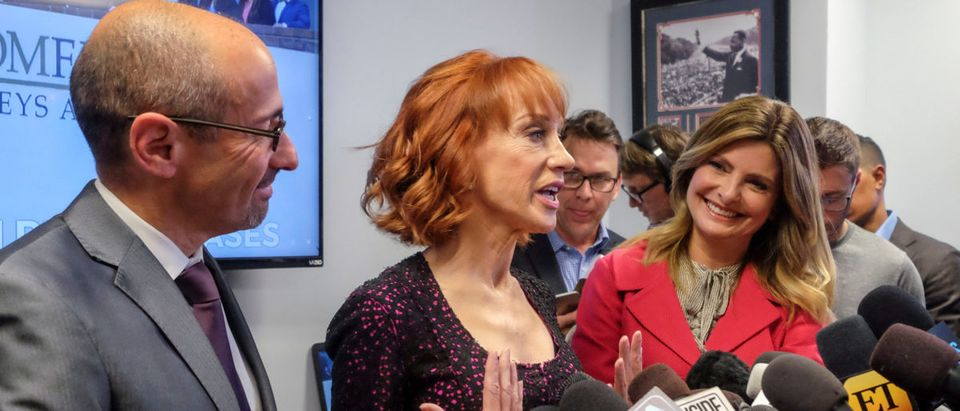 Comedian Kathy Griffin (C) speaks next to her attorneys Dmitry Gorin (L) and Lisa Bloom (R) at a news conference in Woodland Hills, Los Angeles, California, U.S., June 2, 2017. (REUTERS/Ringo Chiu)