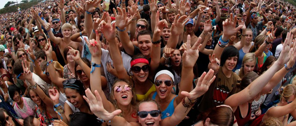 """Music fans wait to listen to """"Foster the People"""" perform at the Lollapalooza music festival in Grant Park in Chicago"""