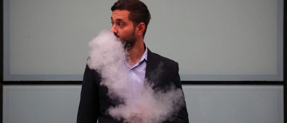 A man vapes outside Southwark Crown Court in London, Britain, September 25, 2017. REUTERS/Hannah McKay | Critical Vote In Florida Anti-Vape Effort