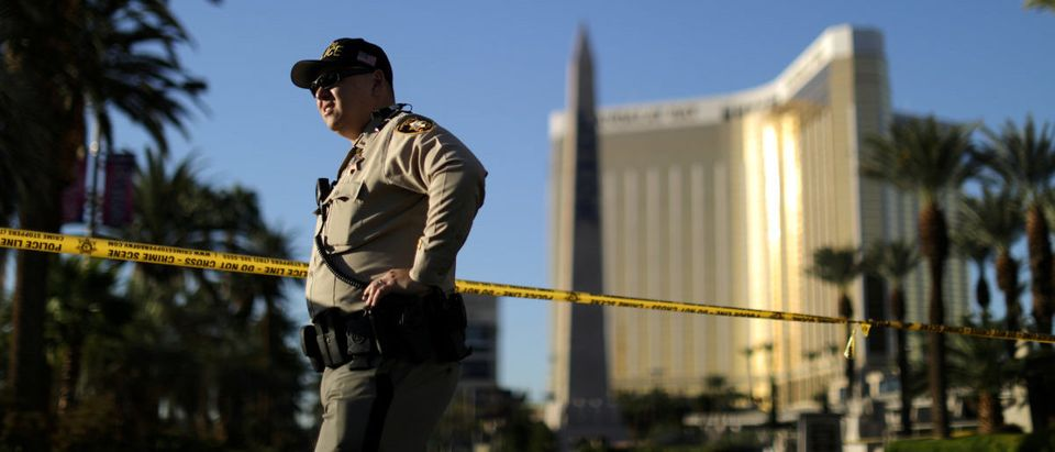 A police officer stands in front of the closed Las Vegas Strip next to the site of the Route 91 music festival mass shooting outside the Mandalay Bay Resort and Casino in Las Vegas