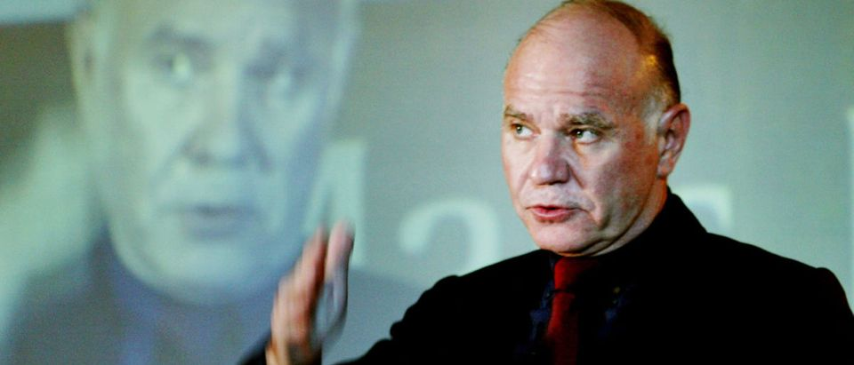 """Hongkong-based international investment adviser Marc Faber speaks during a meeting with investment analysts, in Bombay September 24, 2003. Faber, author of """"The Gloom, Boom & Doom Report"""", has cited Indian bureaucracy as the biggest obstacle to economic growth in Asia's third largest economy. REUTERS/Sherwin Crasto"""