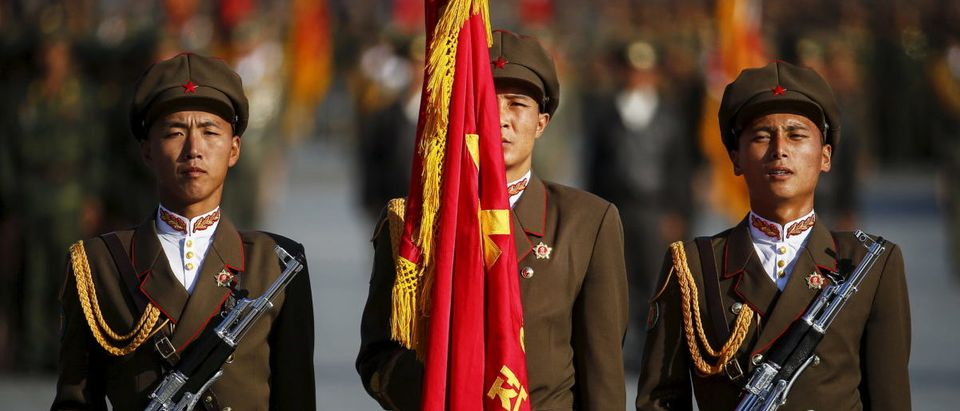 North Korean soldiers stand guard at the beginning of the parade celebrating the 70th anniversary of the founding of Workers' Party of Korea in Pyongyang
