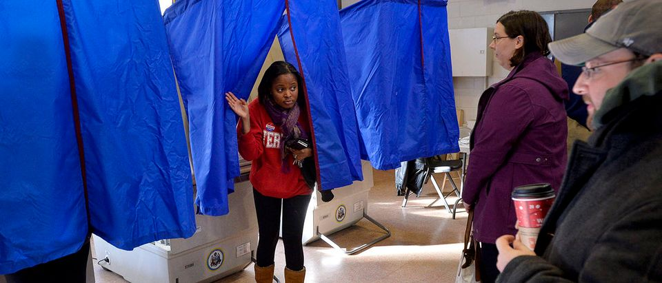 A voter leaves the polling booth during the U.S. presidential election in Philadelphia, Pennsylvania