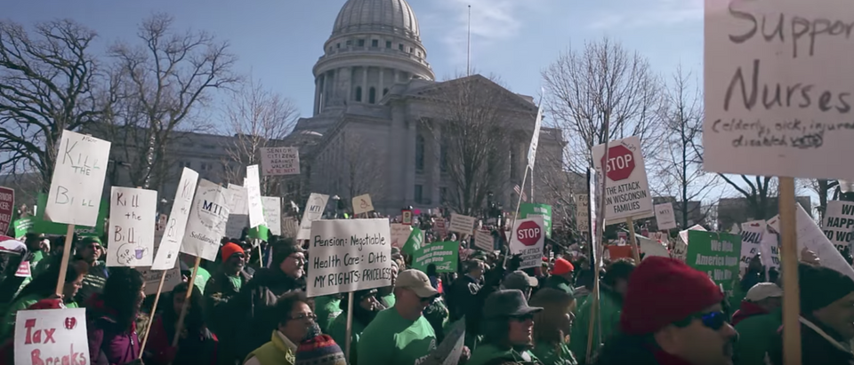 Pro-union protestors march in Wisconsin in 2011. (YouTube screenshot/