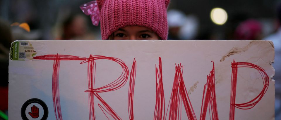 A woman wearing pink pussy protest hat poses for a photograph during the Women's March on Washington, following the inauguration of U.S. President Donald Trump, in Washington, DC, U.S. January 21, 2017. REUTERS/Brian Snyder - RC1C30179000 (Shutterstock)