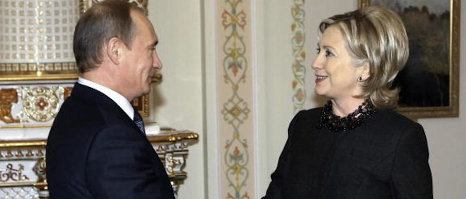 US Secretary of State Hillary Clinton (R) shakes hands with Russian Prime Minister Vladimir Putin (L) outside Moscow in Novo-Ogarevo on March 19, 2010. (Photos: AFP PHOTO / RIA NOVOSTI / POOL / ALEXEY NIKOLSKY)