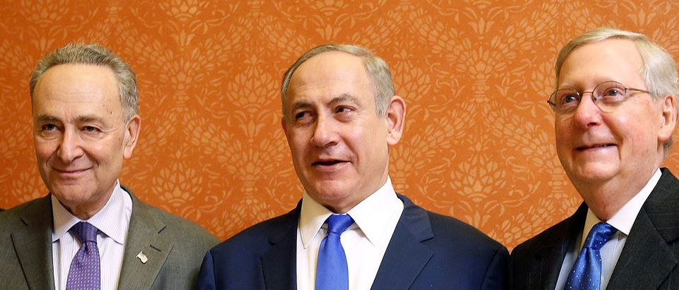 Israeli Prime Minister Benjamin Netanyahu stands with Senate Minority Chuck Schumer (D-NY) and Senate Majority Leader Mitch McConnell (R-KY) at the U.S. Capitol in Washington