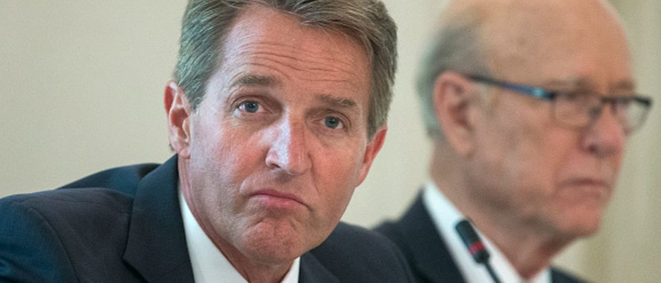 WASHINGTON, DC - JULY 19: (AFP OUT) Sen. Jeff Flake (R-AZ) (L) and Sen. Pat Roberts (R-KS) (R) attend a lunch with members of Congress hosted by US President Donald J. Trump (not pictured) in the State Dining Room of the White House on July 19, 2017 in Washington, DC. (Photo by Michael Reynolds - Pool/Getty Images)