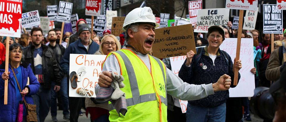 A construction worker chants along with protestors as they march through downtown Seattle in support of Daniel Ramirez Medina, who was detained by U.S. immigration authorities, in Seattle