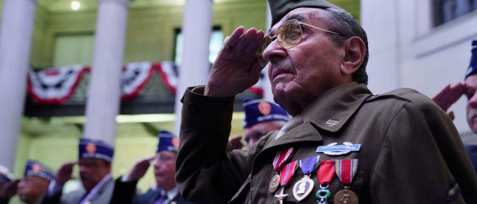 World War II veteran Gasparre salutes during the singing of the U.S. National Anthem at a Purple Heart Reunification ceremony on Purple Heart Day in Manhattan