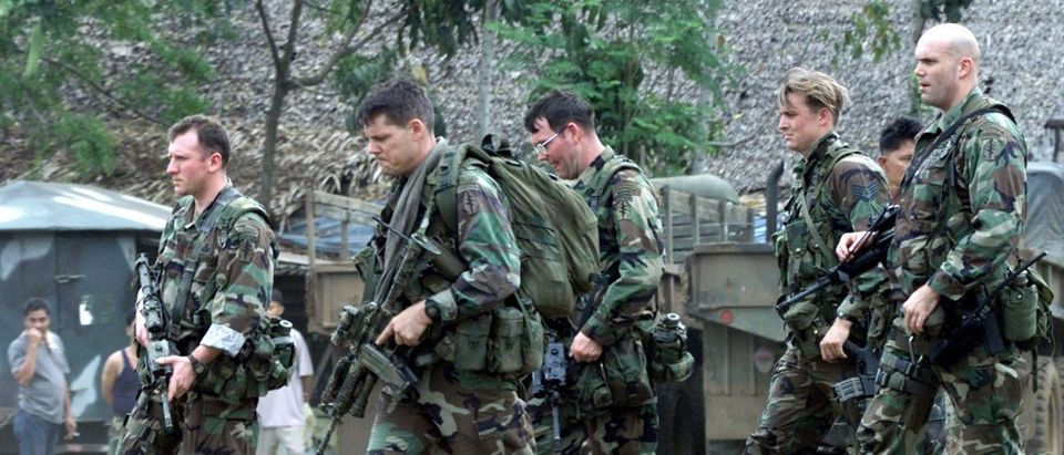 U.S. Green Beret soldiers walk inside the 103rd Philippine Army Brigade camp near Isabela, capital of the southern island of Basilan, after arriving there on February 17, 2002. The Green Beret commandos flew to the island infested with Muslim guerrilas on Sunday and said although they were on a training mission, they were prepared to fight. REUTERS/Erik de Castro.