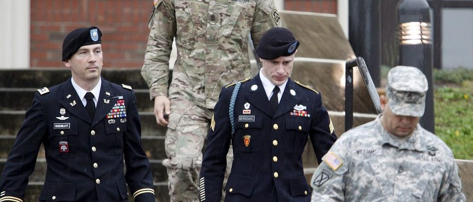 U.S. Army Sergeant Bergdahl leaves the courthouse with his defense attorney, Lt. Col. Rosenblatt, after an arraignment hearing for his court-martial in Fort Bragg