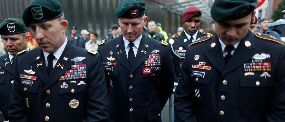 Members of the Green Berets observe a moment of silence during the Horse Soldier Monument Rededication ceremony in front the World Trade Center in New York