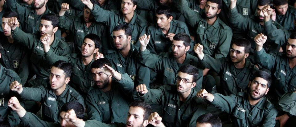 Iranian revolutionary guard corps chant slogans in support of Iran's nuclear programme during Friday prayers in Tehran