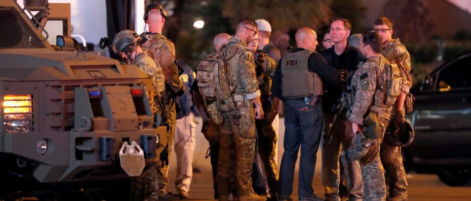 FBI agents confer in front of the Tropicana hotel-casino on October 2, 2017, after a mass shooting during a music festival on the Las Vegas Strip in Las Vegas, Nevada, U.S. REUTERS/Las Vegas Sun/Steve Marcus