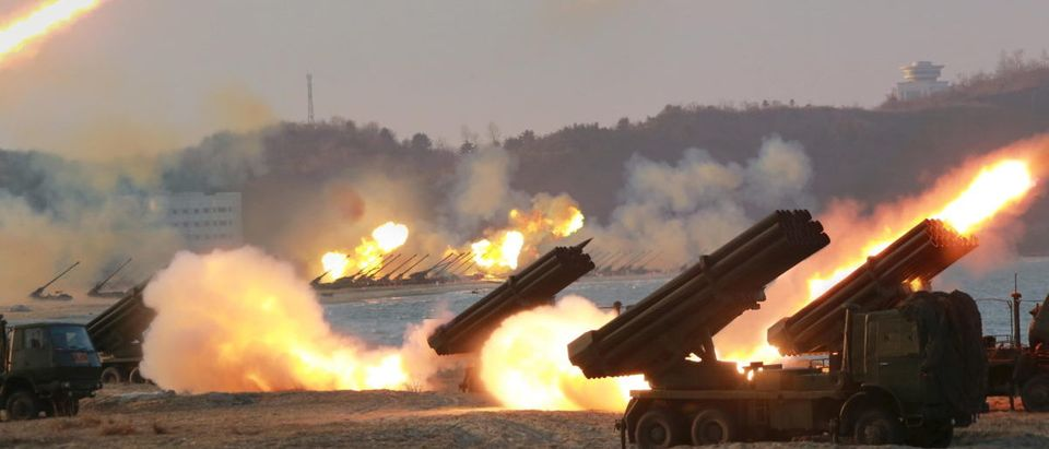 Multiple rocket launchers are seen being fired during a military drill at an unknown location, in this undated photo released by North Korea's Korean Central News Agency (KCNA)