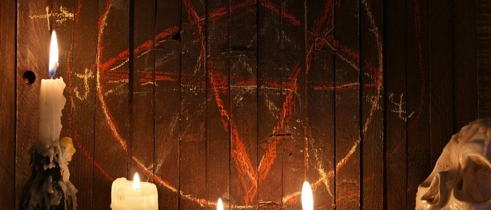 Here is a bloody pentagram on wood background. (Photo: Vera Petruk/Shutterstock)