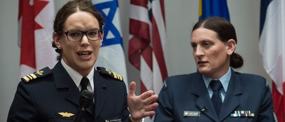 """Transgender Major Alexandra Larsson of the Swedish Armed Forces (L) speaks alongside fellow transgender Sergeant Lucy Jordan (C) of the New Zealand Air Force, during a a conference entitled """"Perspectives on Transgender Military Service from Around the Globe"""" organized by the American Civil Liberties Union (ACLU) and the Palm Center in Washington on October 20, 2014. (Nicholas Kamm/AFP/Getty Images)"""