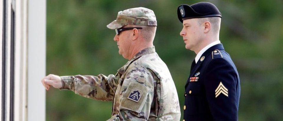U.S. Army Sergeant Bowe Bergdahl (R) is escorted into the courthouse for the sixth day of sentencing proceedings in his court martial at Fort Bragg, North Carolina
