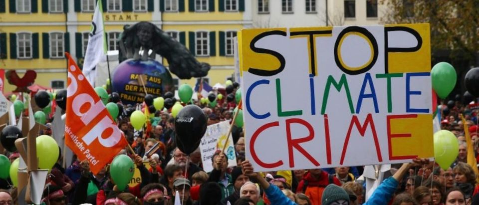 "People march during a demonstration under the banner ""Protect the climate - stop coal"" two days before the start of the COP 23 UN Climate Change Conference hosted by Fiji but held in Bonn"