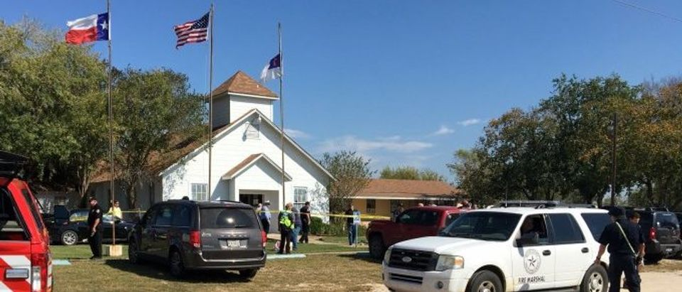 The area around a site of a mass shooting is taped out in Sutherland Springs