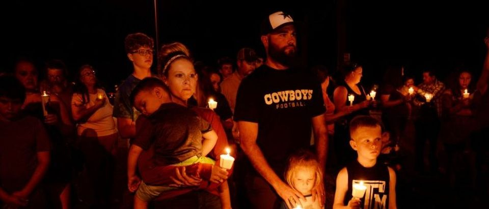 Mourners attend a candle light vigil after a mass shooting at the First Baptist Church in Sutherland Springs