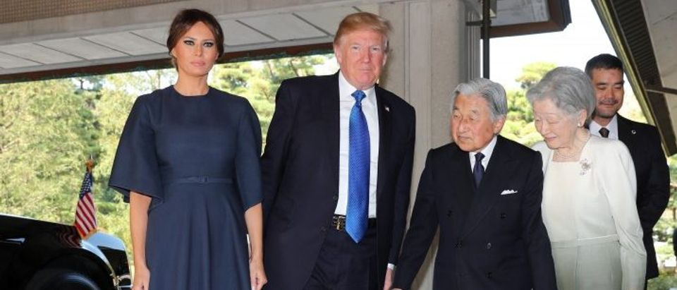 U.S. President Donald Trump and First Lady Melania Trump are welcomed by Emperor Akihito and Empress Michiko upon their arrival at the Imperial Palace in Tokyo
