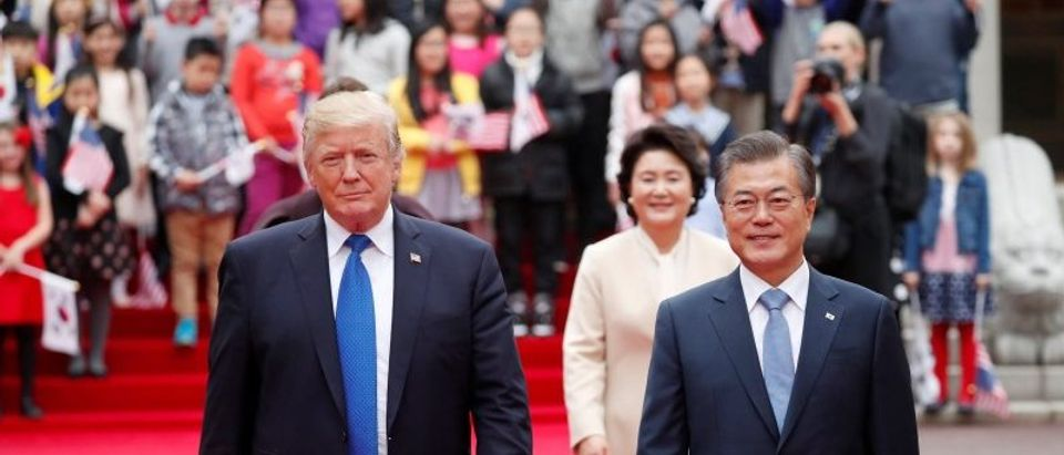 U.S. President Trump walks with South Korea's President Moon Jae-in during a welcoming ceremony in Seoul