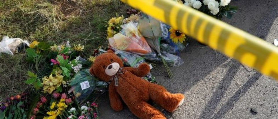 A Teddy bear lies under police tape at a makeshift memorial for those killed in the shooting at the First Baptist Church of Sutherland, Texas, U.S., November 6, 2017. REUTERS/Rick Wilking