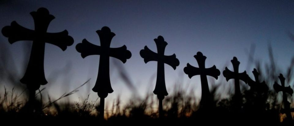 Crosses are seen near a vigil in memory of the victims killed in the shooting at the First Baptist Church of Sutherland