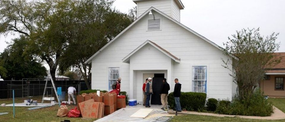 People stand outside the site of the shooting at the First Baptist Church of Sutherland Springs