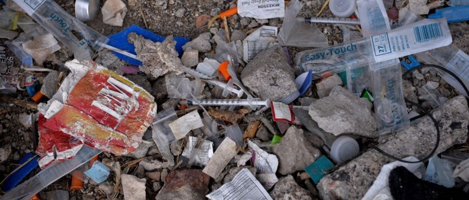 FILE PHOTO: Needles used for shooting heroin and other opioids litter the ground in a park in the Kensington section of Philadelphia