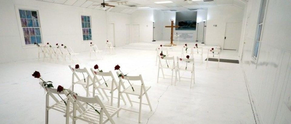 Chairs and roses mark where worshipers were found dead at the First Baptist Church of Sutherland Springs where 26 people were killed one week ago, as the church opens to the public as a memorial to those killed, in Sutherland Springs, Texas, U.S. November 12, 2017. REUTERS/Rick Wilking