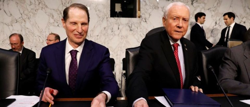 "Orrin Hatch and Ron Wyden arrive for the Senate Finance Committee meeting to markup the ""Tax Cuts and Jobs Act"" in Washington"