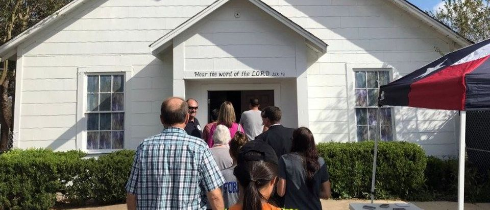 People gather to enter a memorial in the Sutherland Springs First Baptist Church in Texas