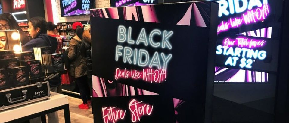 A Black Friday sale sign is displayed outside a makeup store at Roosevelt Field shopping mall in Garden City