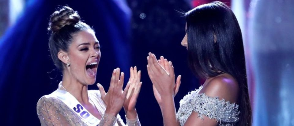 Miss South Africa Demi-Leigh Nel-Peters (L) reacts with first runner-up Miss Colombia Laura Gonzalez as Nel-Peters is announced as Miss Universe during the 66th Miss Universe pageant at Planet Hollywood hotel-casino in Las Vegas