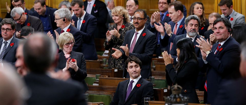Canada's PM Trudeau receives a standing ovation after delivering a speech in the House of Commons in Ottawa