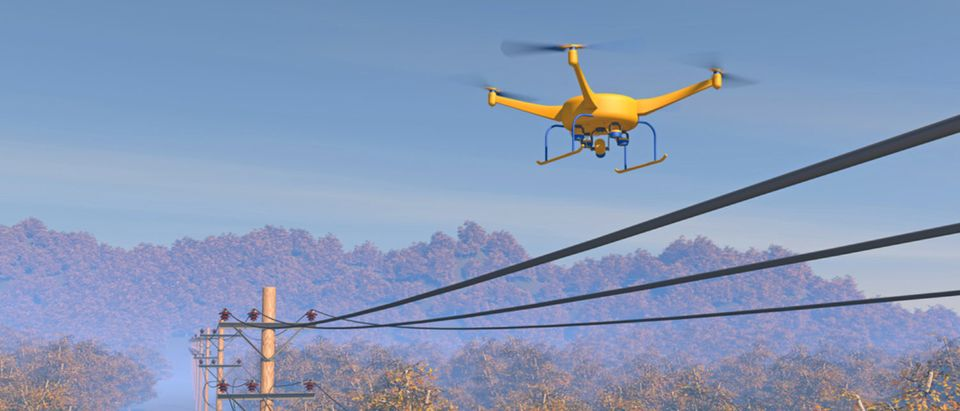 Not the Flying COW from AT&T -- An unmanned aerial vehicle or drone surveying the energy grid.[Shutterstock - PixOne]