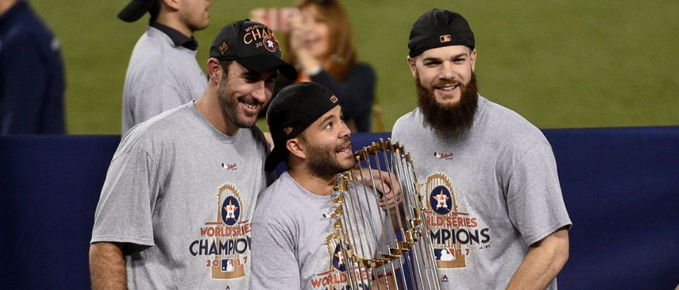 LOS ANGELES, CA - NOVEMBER 01: (L-R) Justin Verlander #35, Jose Altuve #27, and Dallas Keuchel #60 of the Houston Astros hold the Commissioner's Trophy after defeating the Los Angeles Dodgers 5-1 in game seven to win the 2017 World Series at Dodger Stadium on November 1, 2017 in Los Angeles, California. (Photo by Kevork Djansezian/Getty Images)