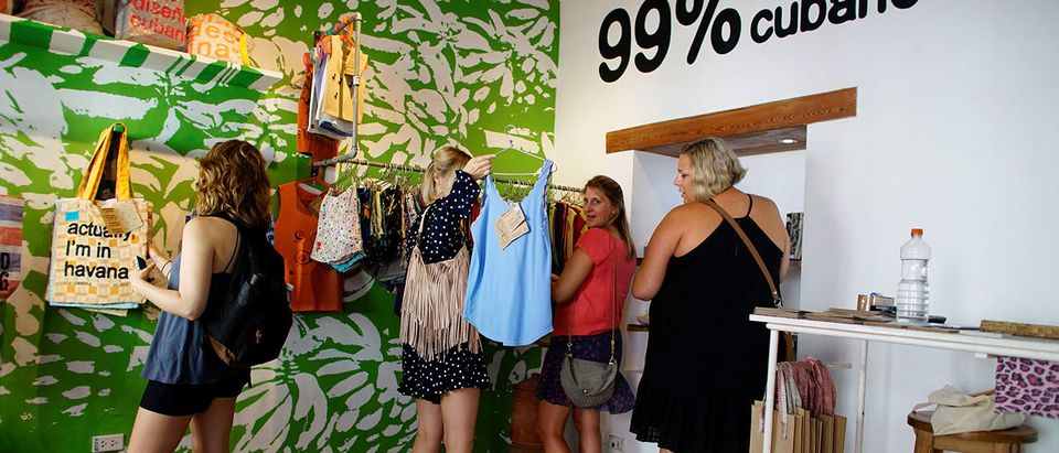 U.S. tourists look at products inside the Cuban private design store Clandestina in Havana, Cuba, October 23, 2017. Picture taken on October 23, 2017. (Photo: REUTERS/Alexandre Meneghini)