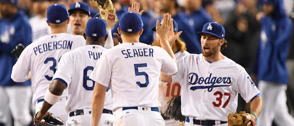 Los Angeles Dodgers second baseman Charlie Culberson (37) and shortstop Corey Seager (5) celebrate after the Los Angeles Dodgers defeated the Houston Astros in game six of the 2017 World Series at Dodger Stadium Oct. 31, 2017, in Los Angeles. (Photo: Robert Hanashiro-USA TODAY Sports)