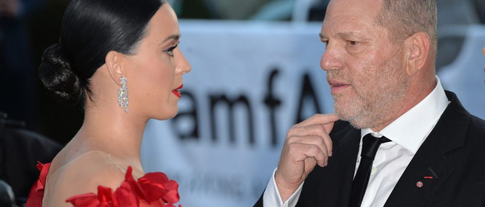 ANTIBES, FRANCE - MAY 19, 2016: Singer Katy Perry & Harvey Weinstein at the amfAR Cinema Against AIDS Gala 2016 at the Hotel du Cap d'Antibes. Featureflash Photo Agency (Shutterstock)