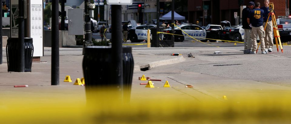 Members of the FBI Evidence Response Team stand at the crime scene in Dallas, Texas, U.S., July 8, 2016. REUTERS/Shannon Stapleton