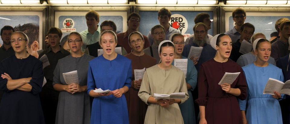 Amish youth from Ohio recite gospel songs in the Times Square subway in Midtown, New York