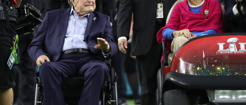Former U.S. President George H.W. Bush and former first lady Barbara Bush arrive on the field ahead of the start of Super Bowl LI between the New England Patriots and the Atlanta Falcons in Houston